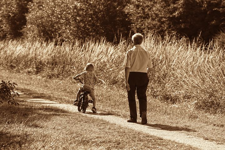 spending time with a grandchild riding his bike