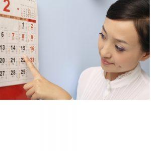 Speech therapist teaches calendar skills as part of aphasia treatment.