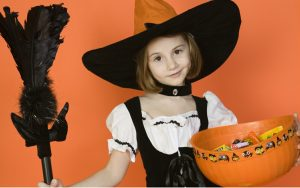 Kids trick-or-treat as part of Halloween activities for seniors